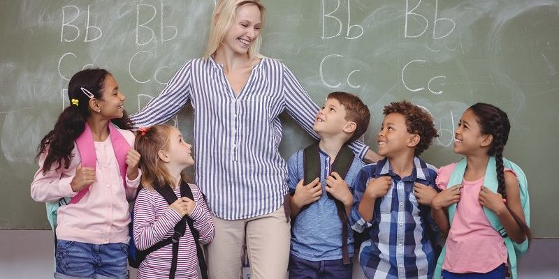 Happy pupils with their teacher