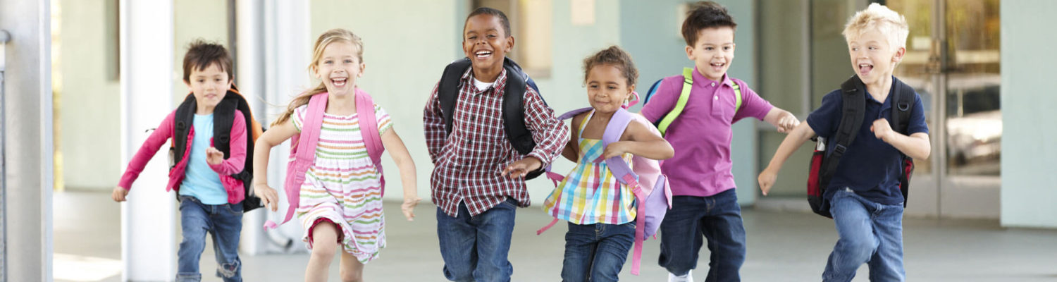 A happy multi-ethnic group of children running