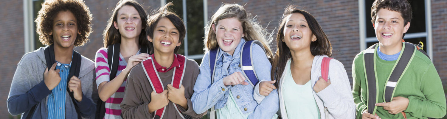 Teenagers smiling to camera